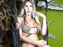 Hung Blonde Shemale stroking her Big Penis in Lingerie and Stokings