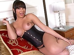 Sweet Holly masturbating in corset