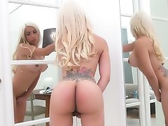 Sassy Blonde with a BIG ROUND BOOTY stripping in the mirror