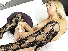 Sexy tgirl Lora posing and playing with herself