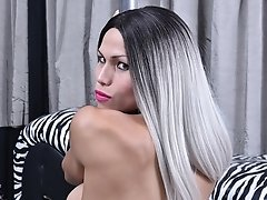 Nycole Sache gets horny on a pole and jerks off her huge dick until she explodes with hot cum